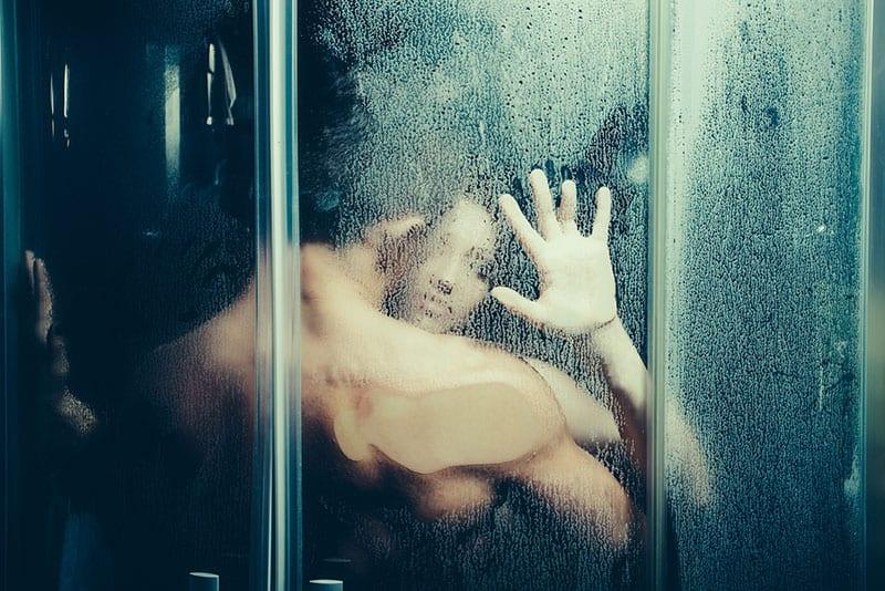 lovers showering together
