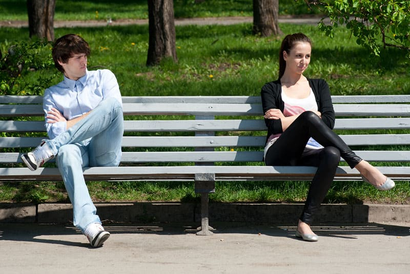 man looking at woman on the bench