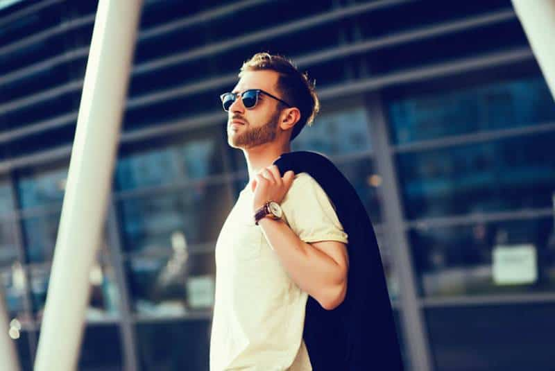man with casual outfit standing outside