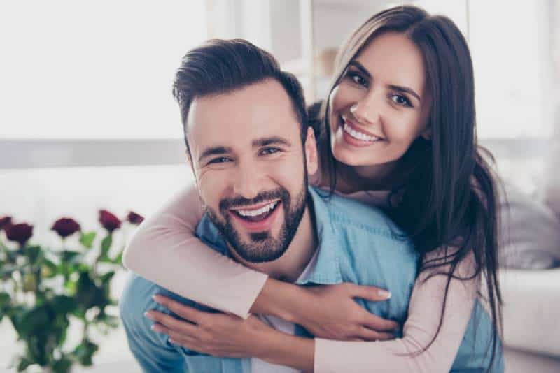 portrait of cheerful couple at home