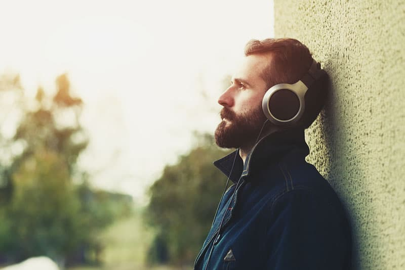 sad man listening to music
