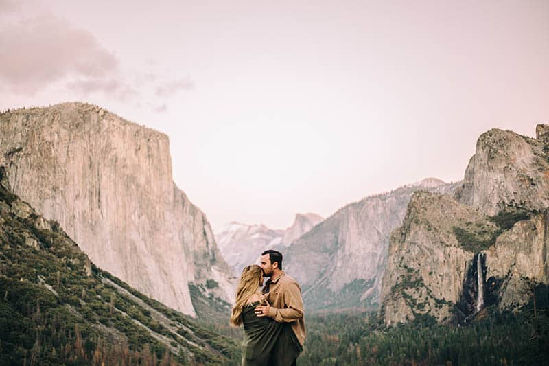Couple hugging in mountains