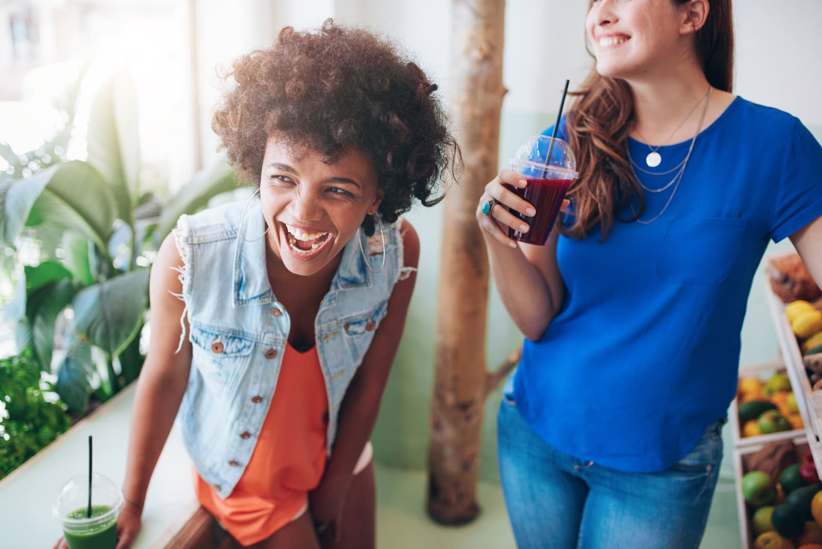 smiling friends drink smoothies