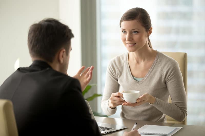 smiling woman listening to man