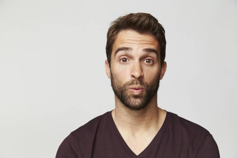 surprised guy lift eyebrows