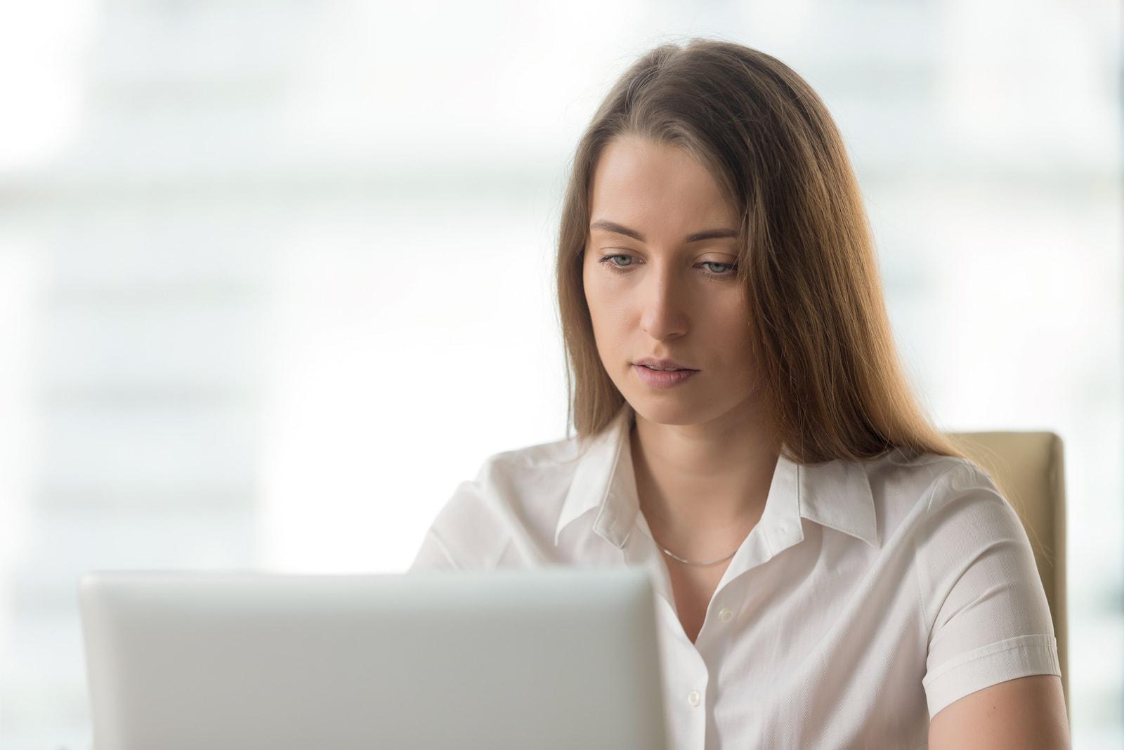 woman sitting by laptop