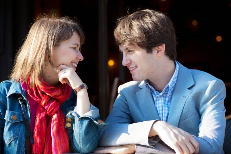 young couple eye contact outside