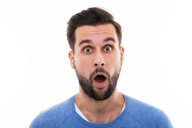 young man looks shocked
