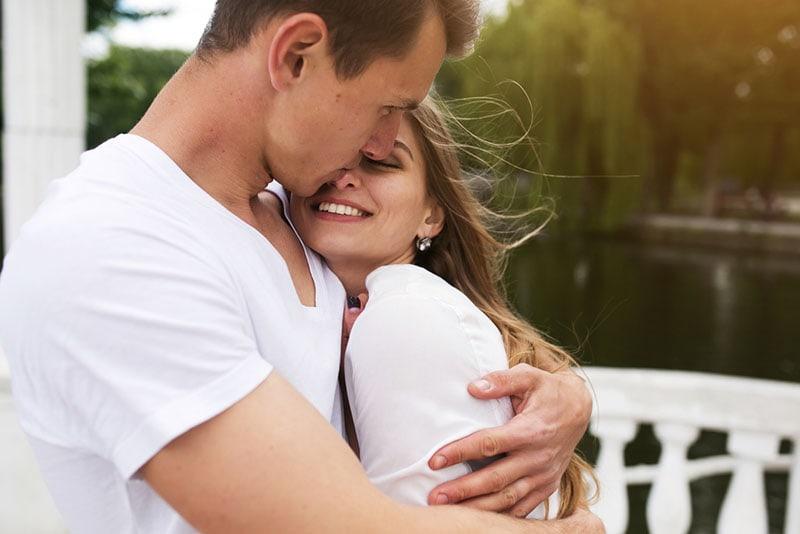man hugging his girlfriend