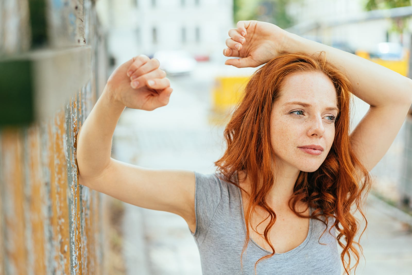 Thoughtful young woman with long red hair
