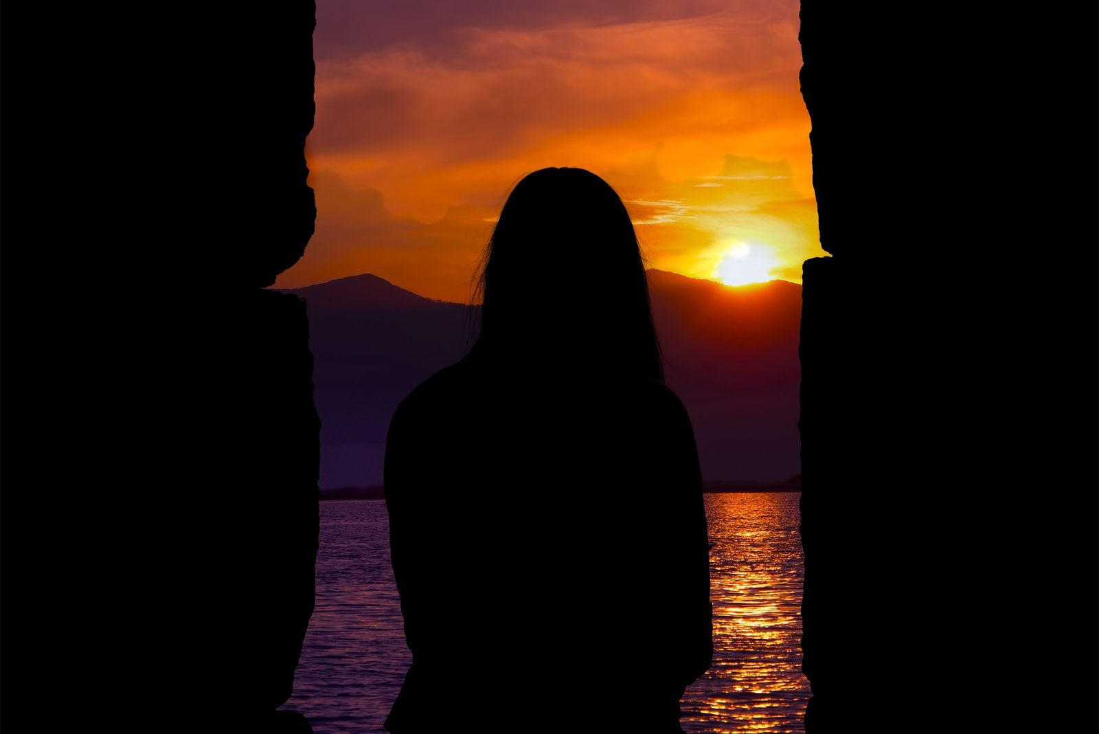 a lonely girl at sunset