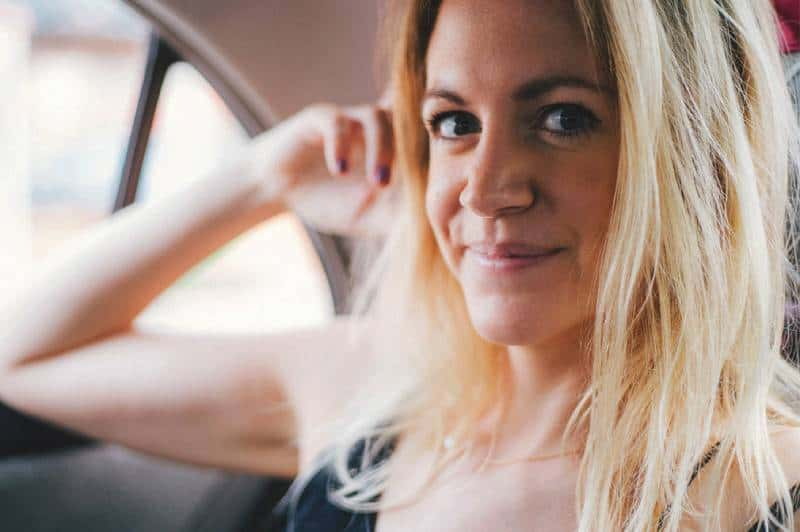 blonde woman smiling in the car