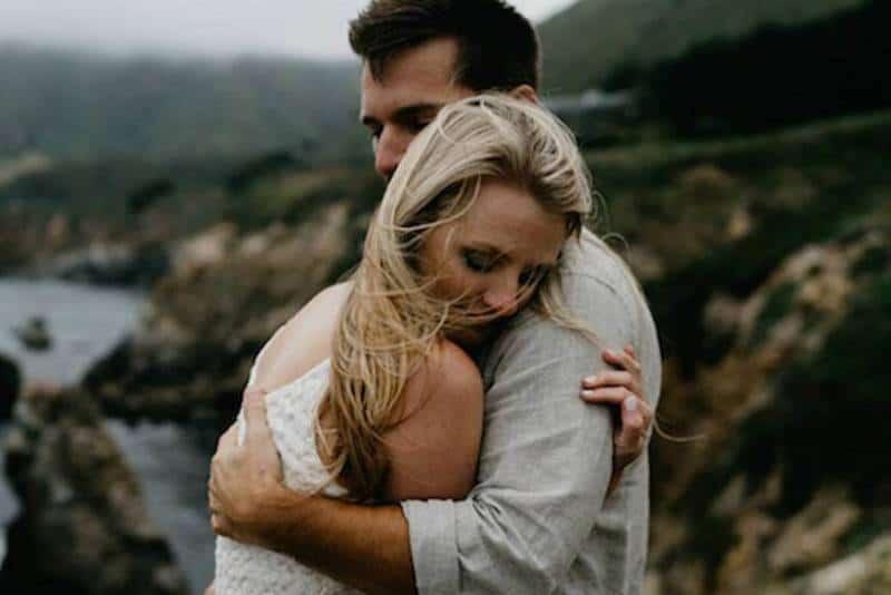 couple hugging on rocks