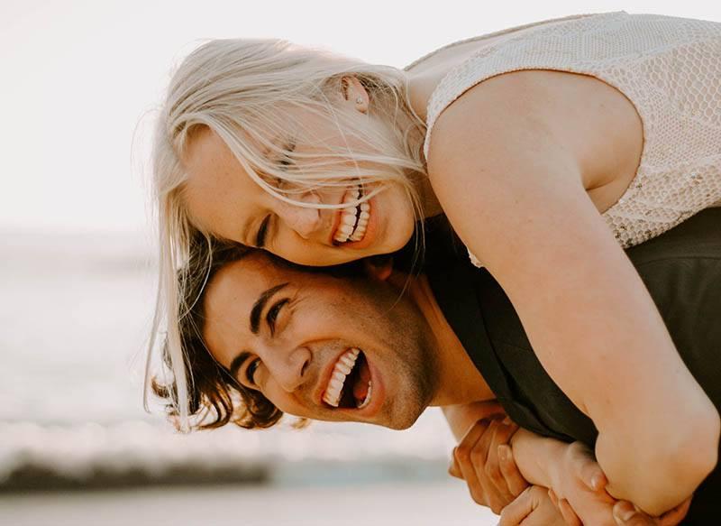 Man and woman having fun at the beach
