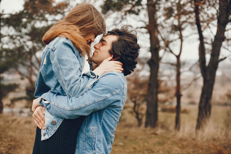happy man holding his girlfriend in arms