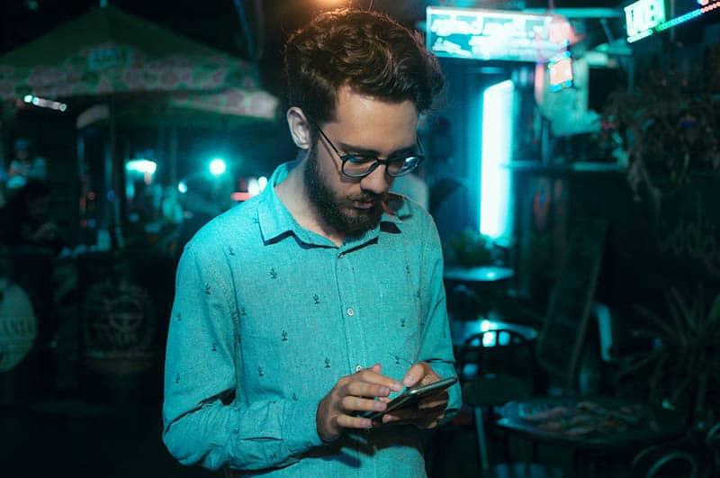 Man typing on phone