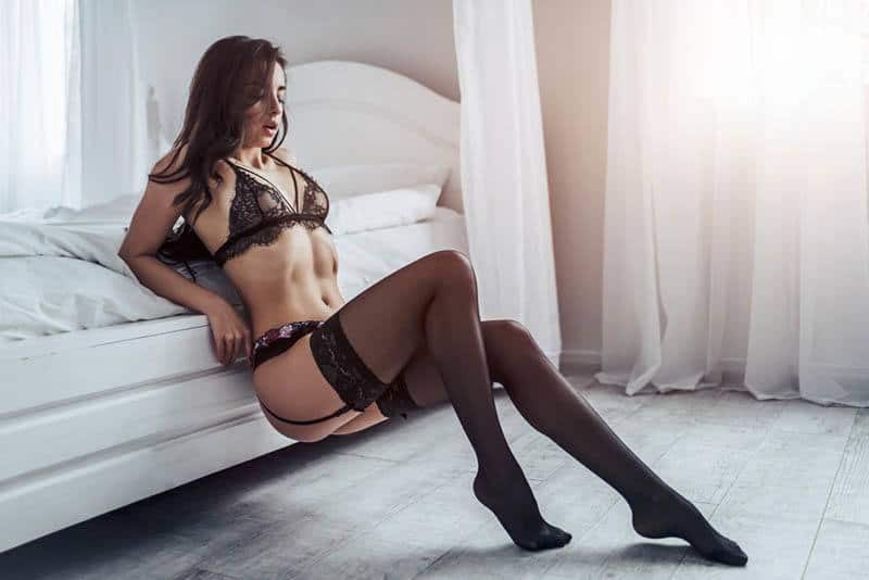 woman wearing sexy underwear at home