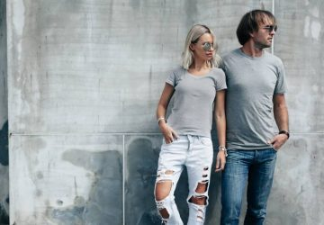 two hipster in grey tshirt standing in front of wall
