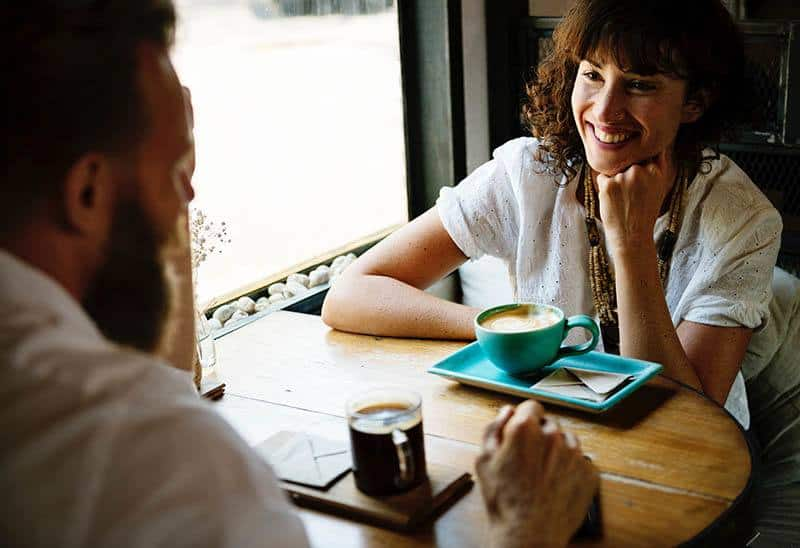 Man and woman at a coffee bar