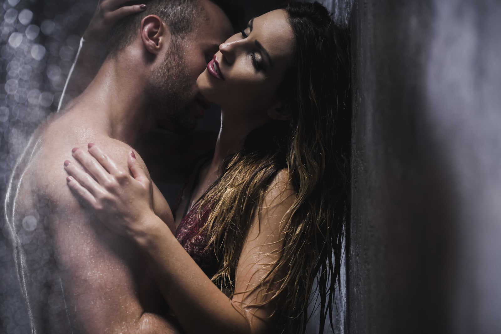 a man kisses a woman in the shower