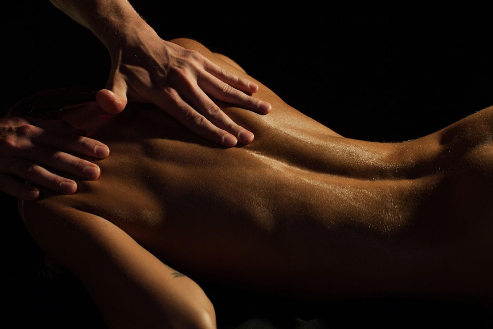 a man massaging a woman