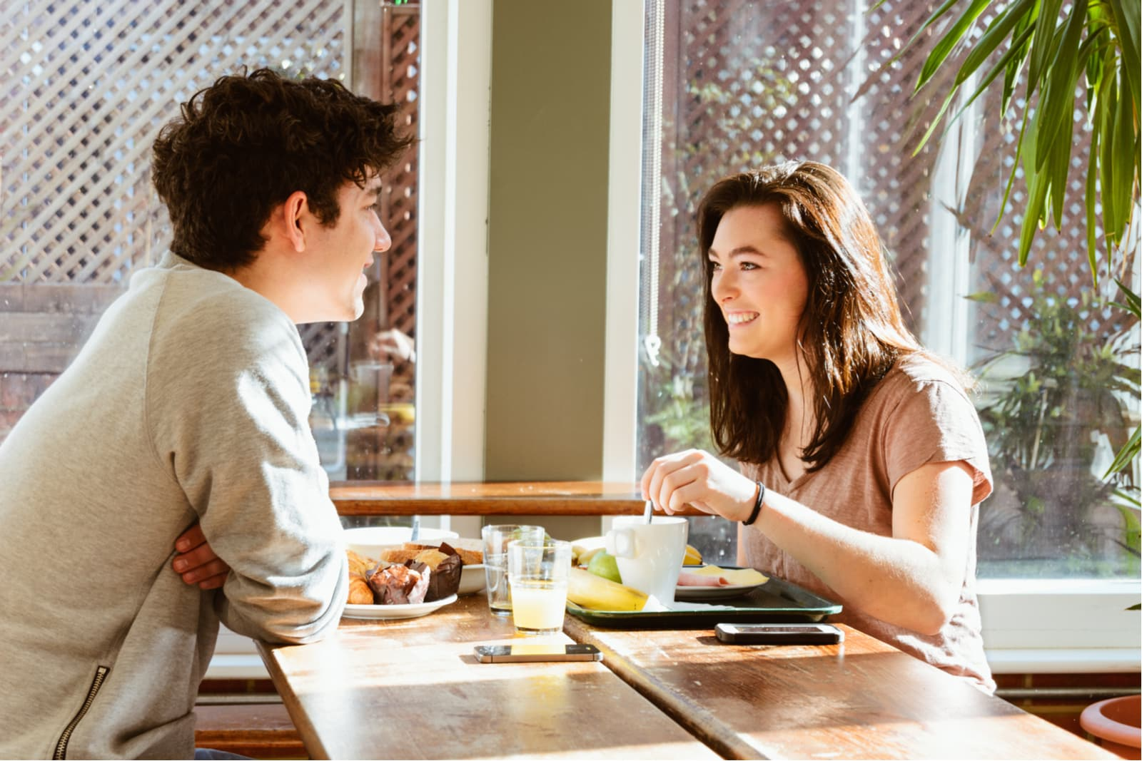 a smiling loving couple having breakfast and talking