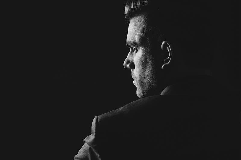 black and white photo of thoughtful man