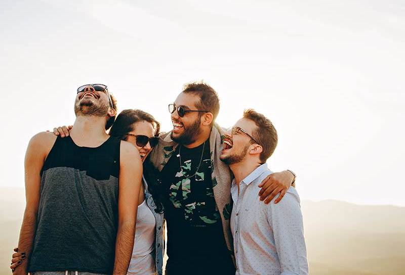 group of friends laughing outside