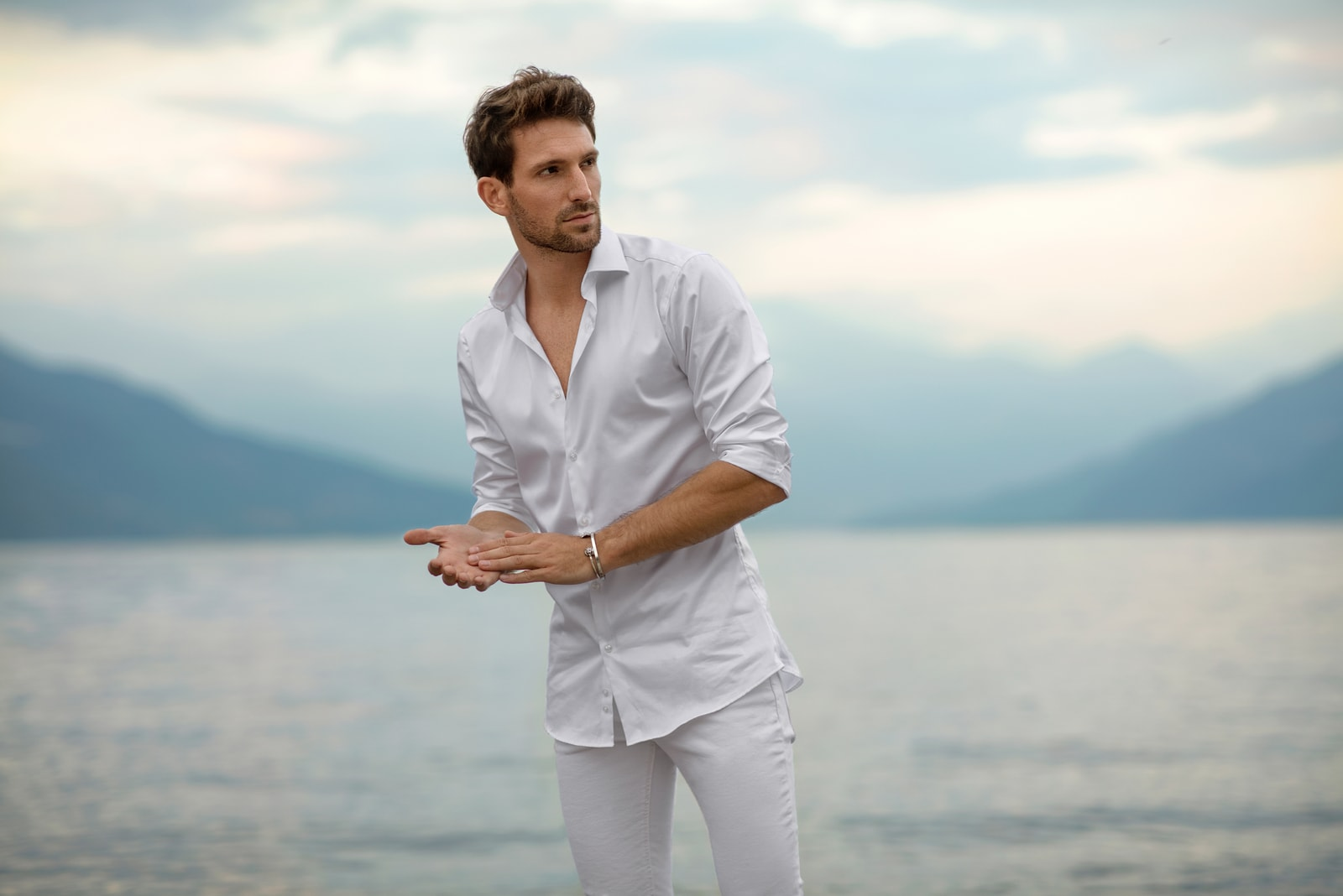 handsome man standing by the lake