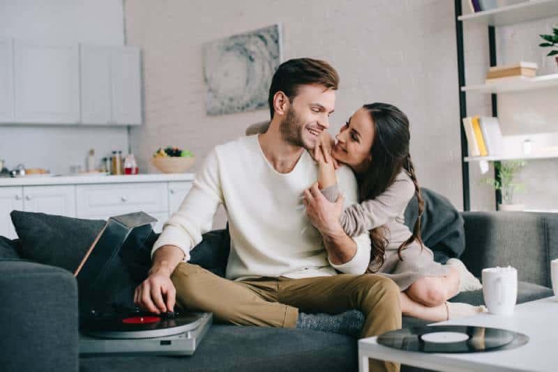 lovely couple listening music in living room