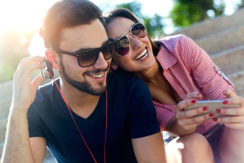 man and woman listening to music