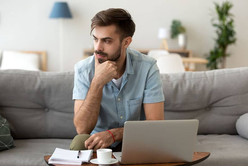 man look thoughtful in living room