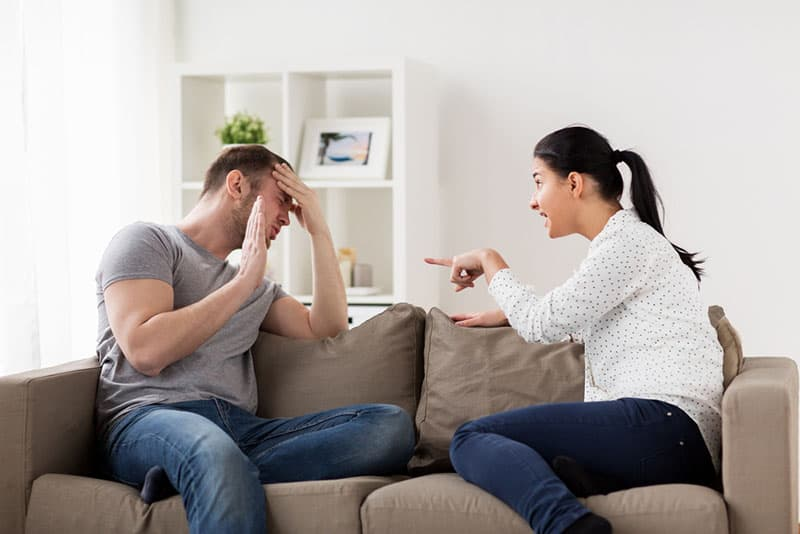 man trying to defense from arguing by her woman