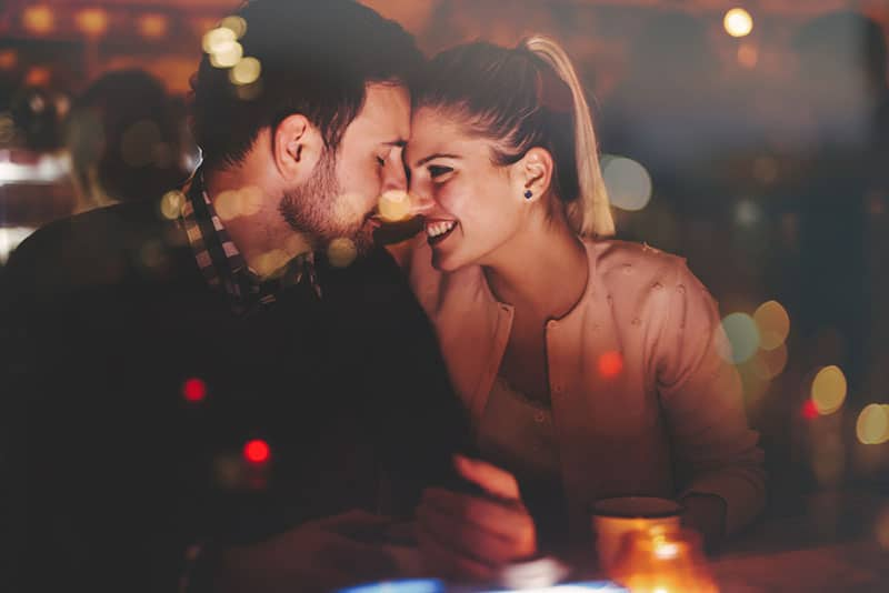 romantic couple sitting in the bar