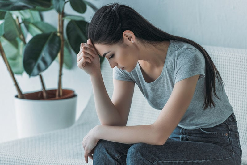 sad woman sitting and thinking