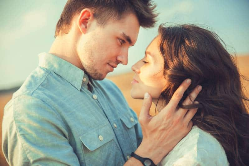 sensual portrait of young couple looking at each other