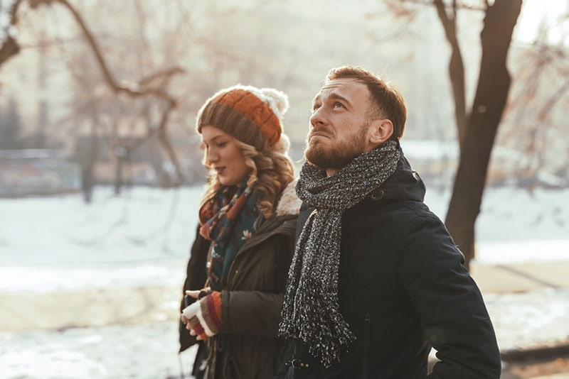 serious couple walking in the park