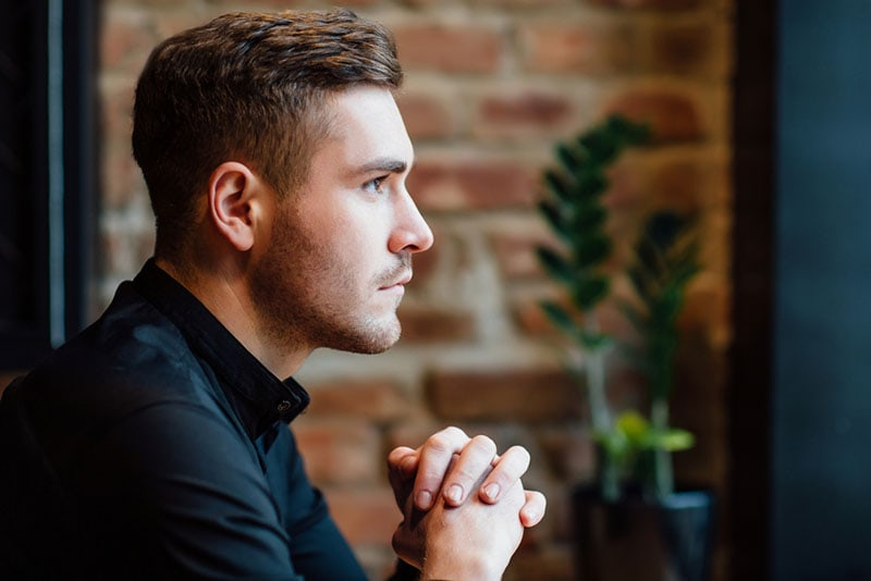 serious mindful man looking at distance