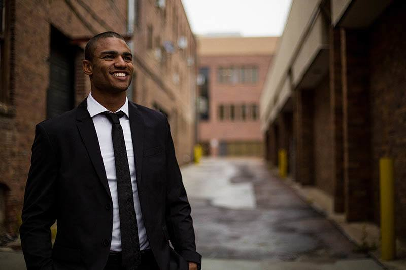 smiling man in suits on street