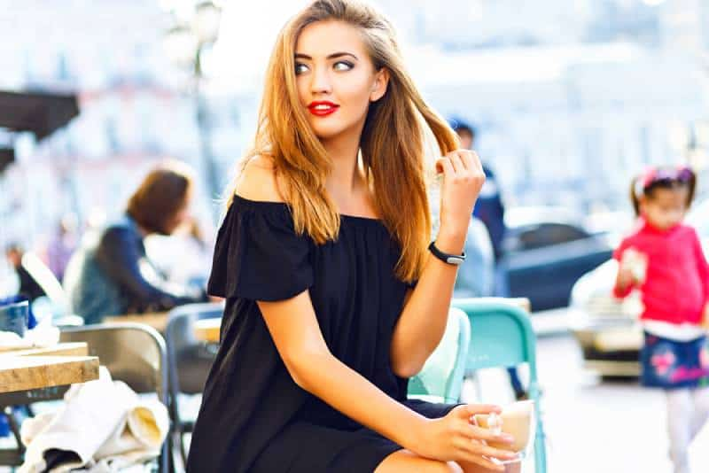 you woman drinking cappuccino in cafe outdoors