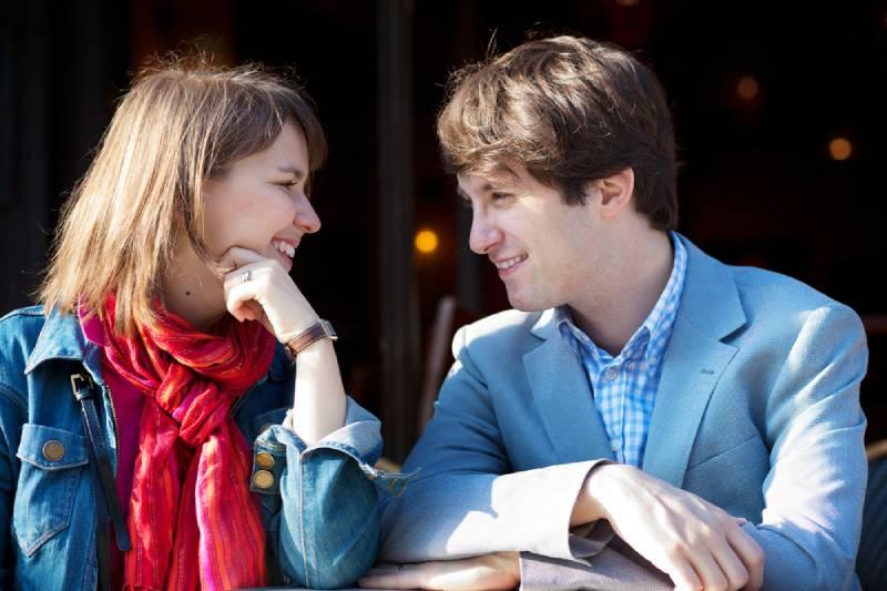 young couple eye contact outside