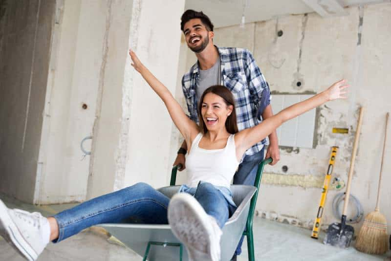 The loving couple is having fun while they renovate the house