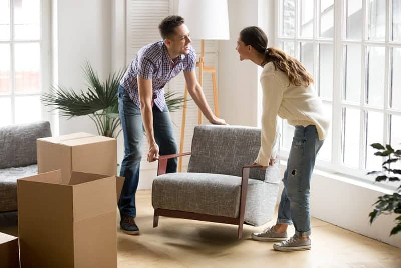 couple replacing chair at home