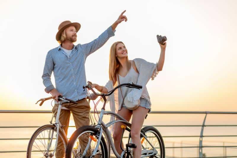 couple riding bike during daytime