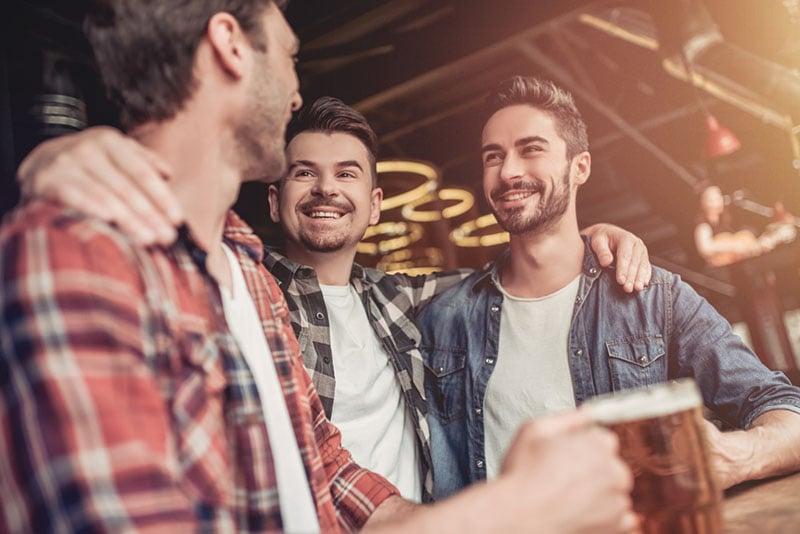 male friends having fun in the pub