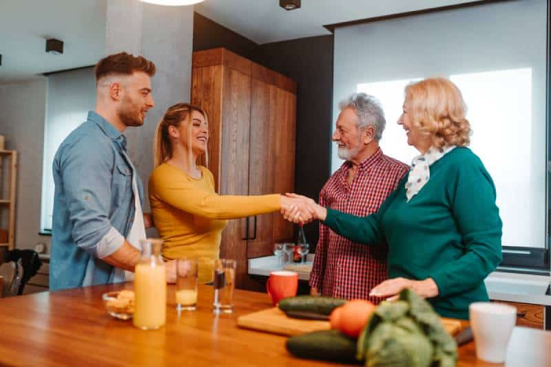 man introducing woman to his family