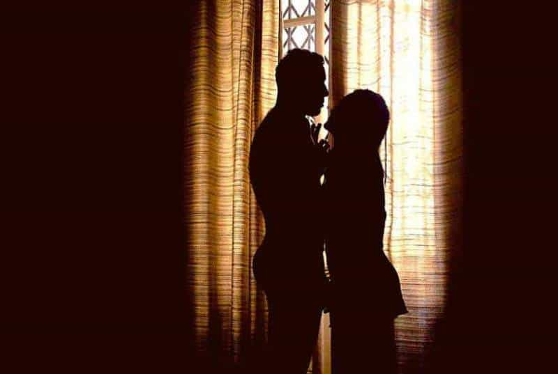 silhouette of man and woman standing close to each other