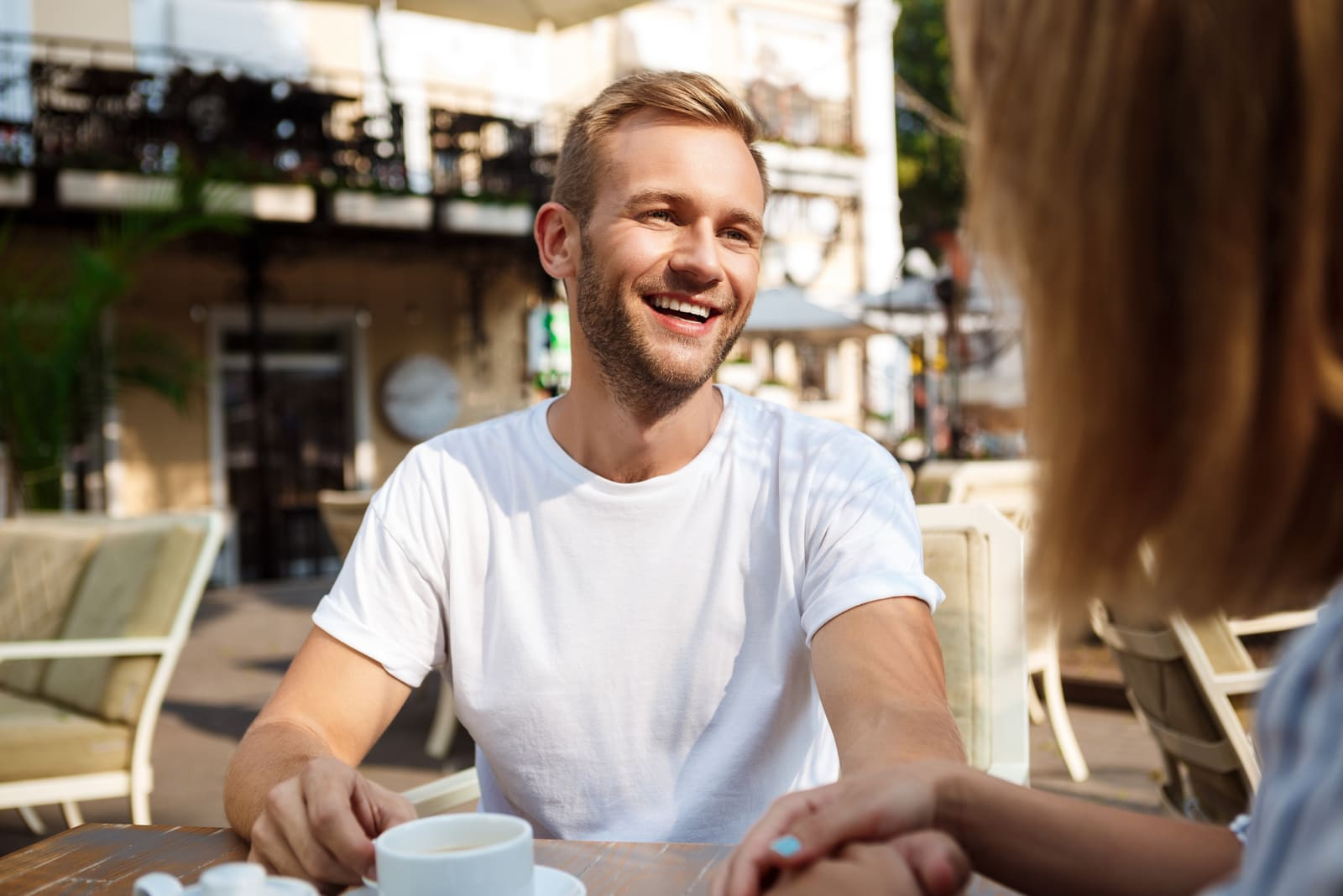 a happy couple in love drinking coffee on the terrace of a cafe