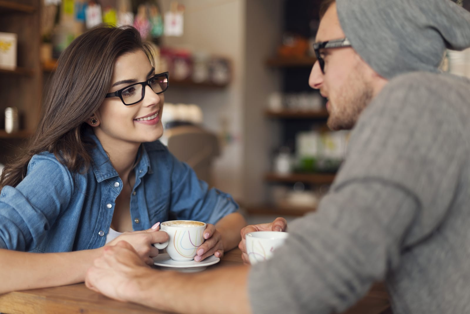 a man and a woman eat coffee and talk