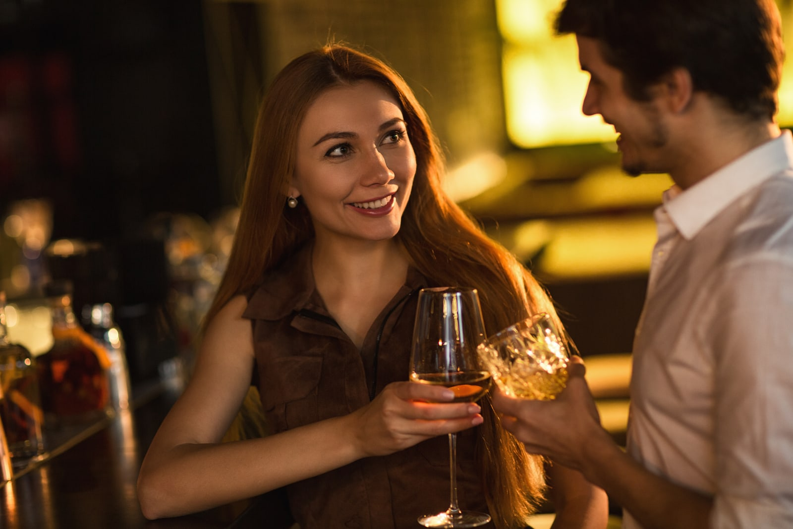 beautiful brunette and man drinking at the bar